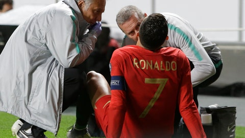 <p>               Portugal's Cristiano Ronaldo receives treatment from medical staff during the Euro 2020 group B qualifying soccer match between Portugal and Serbia at the Luz stadium in Lisbon, Portugal, Monday, March 25, 2019. (AP Photo/Armando Franca)             </p>
