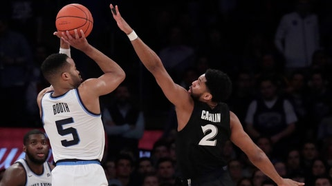 <p>               Villanova guard Phil Booth (5) puts up a shot against Xavier guard Kyle Castlin (2) during overtime of an NCAA college basketball semifinal game in the Big East men's tournament, Friday, March 15, 2019, in New York. Villanova won 71-67 in overtime. (AP Photo/Julio Cortez)             </p>