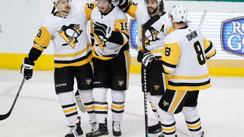 <p>               Pittsburgh Penguins center Jared McCann (19) is congratulated for scoring a goal with teammates Teddy Blueger (53), Kris Letang (58), Brian Dumoulin (8) during the second period of an NHL hockey game against the Dallas Stars in Dallas, Saturday, March 23, 2019. (AP Photo/LM Otero)             </p>