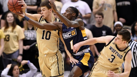 <p>               Wofford guard Nathan Hoover (10), UNC-Greensboro guard Isaiah Miller (1) and Wofford guard Fletcher Magee (3) scramble for the ball in the first half of an NCAA college basketball game for the Southern Conference tournament championship, Monday, March 11, 2019, in Asheville, N.C. (AP Photo/Kathy Kmonicek)             </p>