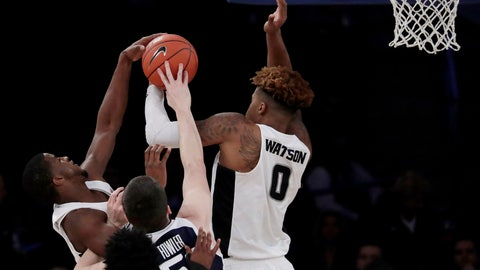 <p>               Butler guard Paul Jorgensen (5) fights for possession with Providence guard Alpha Diallo, left, and center Nate Watson (0) during the first half of an NCAA college basketball game in the Big East men's tournament Wednesday, March 13, 2019, in New York. (AP Photo/Julio Cortez)             </p>