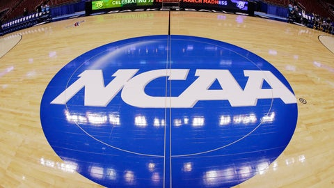 <p>               FILE - In this March 21, 2013, file photo taken with a fisheye lens, the NCAA logo is displayed at mid-court before Albany's practice for a second-round game of the NCAA college basketball tournament in Philadelphia. A judge has ruled against the NCAA in a federal antitrust lawsuit, saying football and basketball players should be permitted to receive more compensation from schools but only if the benefits are tied to education. (AP Photo/Matt Slocum, File)             </p>