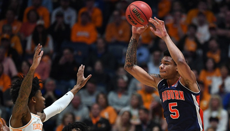 Okeke's 18 points and 13 rebounds help No. 22 Auburn upset No. 8 Tennessee in SEC Championship
