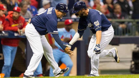 Mar 30, 2019; Milwaukee, WI, USA; Milwaukee Brewers second baseman Mike Moustakas (11) celebrates with third base coach Ed Sedar (6) after hitting a home run during the third inning against the St. Louis Cardinals at Miller Park. Mandatory Credit: Jeff Hanisch-USA TODAY Sports