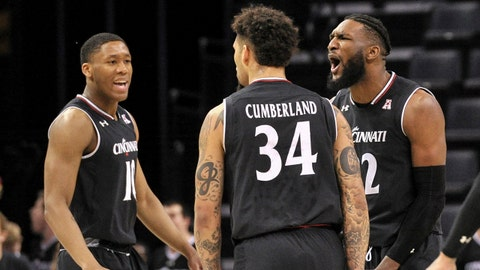 Mar 17, 2019; Memphis, TN, USA; Cincinnati Bearcats guard Rashawn Fredericks (10) and Cincinnati Bearcats guard Jarron Cumberland (34) and Cincinnati Bearcats forward Eliel Nsoseme (22) celebrate during the second half against the Houston Cougars in the American Athletic Conference Tournament at FedExForum. Mandatory Credit: Justin Ford-USA TODAY Sports