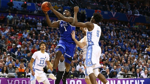 Mar 15, 2019; Charlotte, NC, USA; Duke Blue Devils forward Zion Williamson (1) shoots against North Carolina Tar Heels forward Nassir Little (5) in the ACC conference tournament at Spectrum Center. Mandatory Credit: Jeremy Brevard-USA TODAY Sports