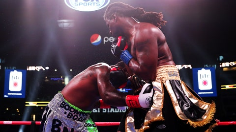 ARLINGTON, TEXAS - MARCH 16: Gregory Corbin lands a punch below the belt against Charles Martin and was disqualified during FS1 Heavyweight Bout at AT