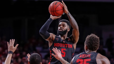 CINCINNATI, OH - MARCH 10: Corey Davis Jr. #5 of the Houston Cougars shoots the ball over Rashawn Fredericks #10 of the Cincinnati Bearcats at Fifth Third Arena on March 10, 2019 in Cincinnati, Ohio. (Photo by Michael Hickey/Getty Images)