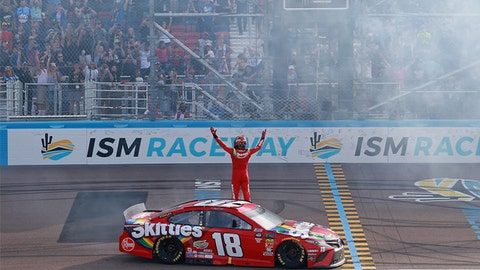 AVONDALE, AZ - MARCH 10:  Kyle Busch, driver of the #18 Skittles Toyota, celebrates with a burnout after winning the Monster Energy NASCAR Cup Series TicketGuardian 500 at ISM Raceway on March 10, 2019 in Avondale, Arizona.  (Photo by Matt Sullivan/Getty Images)
