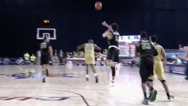 North Texas' Ryan Woolridge knocks down full court heave at the buzzer