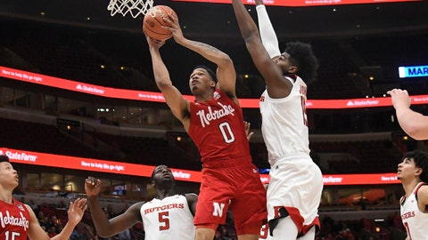 Mar 13, 2019; Chicago, IL, USA; Rutgers Scarlet Knights center Myles Johnson (15) defends Nebraska Cornhuskers guard James Palmer Jr. (0) during the first half in the Big Ten conference tournament at United Center. Mandatory Credit: David Banks-USA TODAY Sports