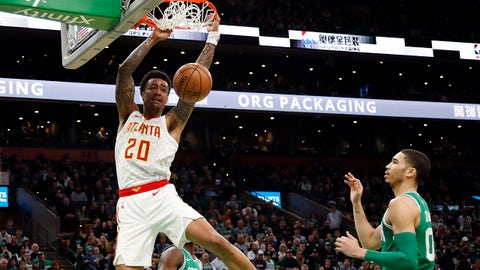 Mar 16, 2019; Boston, MA, USA; Atlanta Hawks forward John Collins (20) dunks as Boston Celtics forward Jayson Tatum (0) looks on during the second half at TD Garden. Mandatory Credit: Winslow Townson-USA TODAY Sports