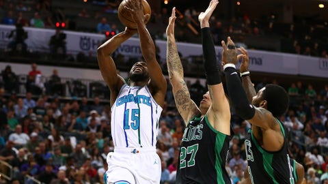 Mar 23, 2019; Charlotte, NC, USA; Charlotte Hornets guard Kemba Walker (15) shoots the ball against Boston Celtics forward Daniel Theis (27) in the first half at Spectrum Center. Mandatory Credit: Jeremy Brevard-USA TODAY Sports