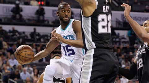 Mar 26, 2019; Charlotte, NC, USA; Charlotte Hornets guard Kemba Walker (15) passes the ball against San Antonio Spurs forward Rudy Gay (22) during the second half at the Spectrum Center. The Hornets won in overtime 125-116. Mandatory Credit: Sam Sharpe-USA TODAY Sports
