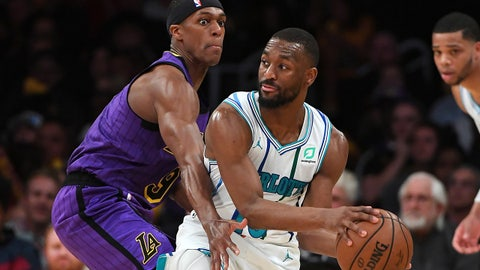 Mar 29, 2019; Los Angeles, CA, USA; Charlotte Hornets guard Kemba Walker (15) looks to pass the ball as Los Angeles Lakers guard Rajon Rondo (9) defends in the second half of the game at Staples Center. Mandatory Credit: Jayne Kamin-Oncea-USA TODAY Sports