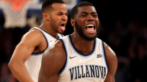 NEW YORK, NEW YORK - MARCH 15:  Eric Paschall #4 and Phil Booth #5 of the Villanova Wildcats celebrate in the final minutes of the game against the Xavier Musketeers during the semifinal round of the Big East Tournament at Madison Square Garden on March 15, 2019 in New York City. (Photo by Elsa/Getty Images)