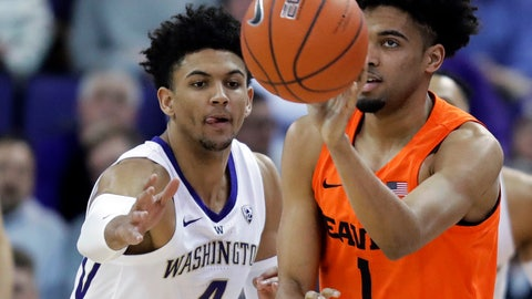 <p>               Oregon State guard Stephen Thompson Jr. (1) gets a pass off next to Washington guard Matisse Thybulle (4) during the first half of an NCAA college basketball game Wednesday, March 6, 2019, in Seattle. (AP Photo/Ted S. Warren)             </p>