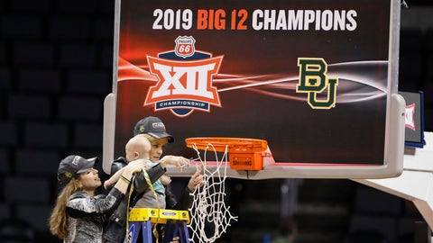 <p>               Baylor head coach Kim Mulkey holds her grandson, assisted by her daughter Makenzie Fuller, as she cuts down the nets after Baylor defeated Iowa State during the Big 12 women's conference tournament championship in Oklahoma City, Monday, March 11, 2019. Baylor won 67-49. (AP Photo/Alonzo Adams)             </p>