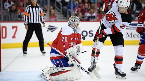 <p>               Washington Capitals goaltender Braden Holtby (70) tries to corral the puck, next to New Jersey Devils center Blake Coleman (20) during the first period of an NHL hockey game Friday, March 8, 2019, in Washington. (AP Photo/Nick Wass)             </p>