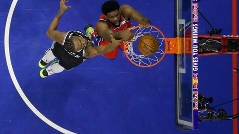 <p>               Philadelphia 76ers' Joel Embiid, right, dunks the ball past Sacramento Kings' Harry Giles III during the first half of an NBA basketball game, Friday, March 15, 2019, in Philadelphia. (AP Photo/Matt Slocum)             </p>