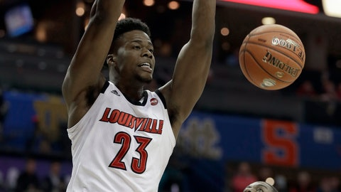 <p>               Louisville's Steven Enoch (23) dunks past Notre Dame's Juwan Durham (11) during the first half of an NCAA college basketball game in the Atlantic Coast Conference tournament in Charlotte, N.C., Wednesday, March 13, 2019. (AP Photo/Nell Redmond)             </p>
