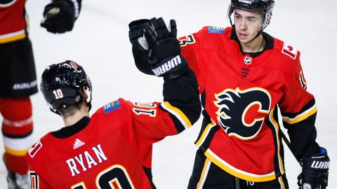 <p>               Calgary Flames' Johnny Gaudreau, right, celebrates his goal with teammate Derek Ryan during the first period of an NHL hockey game in Calgary, Alberta, Tuesday, March 19, 2019. (Jeff McIntosh/The Canadian Press via AP)             </p>