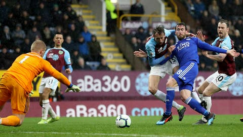 <p>               Burnley's Peter Crouch, third right, and Leicester City's Christian Fuchs, second right, battle for the ball as Leicester City goalkeeper Kasper Schmeichel, left, dives for the ball during their English Premier League soccer match at Turf Moor, Burnley, England, Saturday, March 16, 2019. (Martin Ricketts/PA via AP)             </p>
