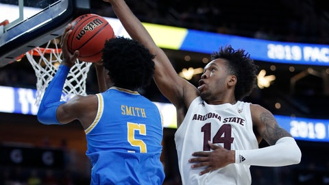 <p>               Arizona State's Kimani Lawrence, right, blocks a shot by UCLA's Chris Smith during the first half of an NCAA college basketball game in the quarterfinals of the Pac-12 men's tournament Thursday, March 14, 2019, in Las Vegas. (AP Photo/John Locher)             </p>