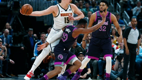 <p>               Denver Nuggets center Nikola Jokic, back left, looks to pass the ball as Minnesota Timberwolves guard Josh Okogie, left front, and center Karl-Anthony Towns defend in the first half of an NBA basketball game, Tuesday, March 12, 2019, in Denver. (AP Photo/David Zalubowski)             </p>