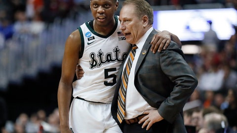 <p>               Michigan State guard Cassius Winston (5) puts his arm around coach Tom Izzo following the team's 80-63 win over LSU in an NCAA men's college basketball tournament East Region semifinal in Washington, Friday, March 29, 2019. (AP Photo/Patrick Semansky)             </p>