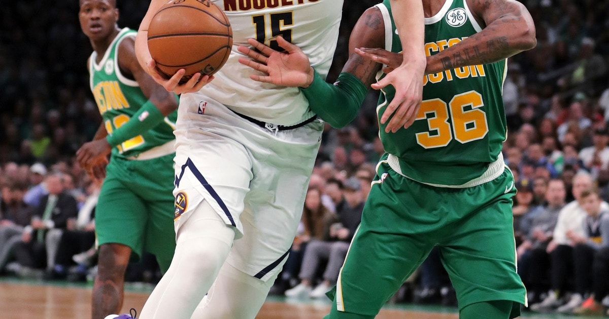 5d47b62a4120 Nuggets clinch playoff spot with win over Celtics