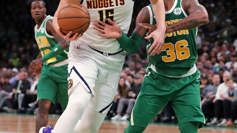 <p>               Denver Nuggets center Nikola Jokic (15) drives to the basket against Boston Celtics guard Marcus Smart (36) during the second half of an NBA basketball game in Boston, Monday, March 18, 2019. (AP Photo/Charles Krupa)             </p>