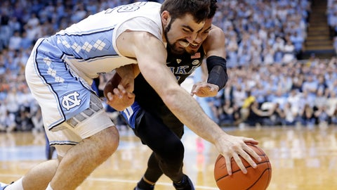 <p>               North Carolina's Luke Maye, left, and Duke's Tre Jones battle for the ball during the first half of an NCAA college basketball game in Chapel Hill, N.C., Saturday, March 9, 2019. (AP Photo/Gerry Broome)             </p>