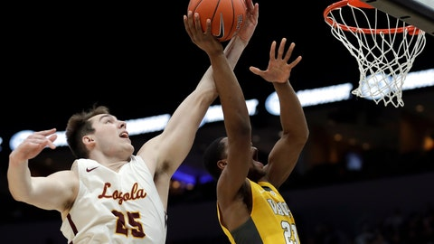<p>               Loyola of Chicago's Cameron Krutwig, left, knocks the ball away from Valparaiso's Mileek McMillan during the second half of an NCAA college basketball game in the quarterfinal round of the Missouri Valley Conference tournament, Friday, March 8, 2019, in St. Louis. Loyola won 67-54. (AP Photo/Jeff Roberson)             </p>
