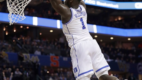 <p>               Duke's Zion Williamson (1) goes up to dunk against Syracuse during the first half of an NCAA college basketball game in the Atlantic Coast Conference tournament in Charlotte, N.C., Thursday, March 14, 2019. (AP Photo/Nell Redmond)             </p>