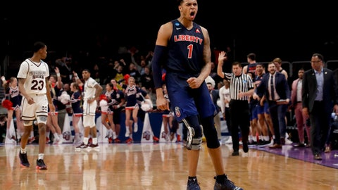 <p>               Liberty guard Caleb Homesley celebrates after scoring against Mississippi State during the second half of a first-round game in the NCAA men's college basketball tournament Friday, March 22, 2019, in San Jose, Calif. (AP Photo/Jeff Chiu)             </p>