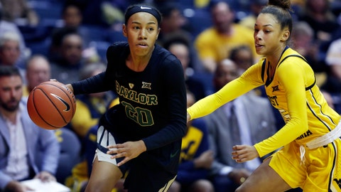 <p>               Baylor guard Juicy Landrum (20) drives while defended by West Virginia guard Lucky Rudd (15) during the first half of an NCAA college basketball game Monday, March 4, 2019, in Morgantown, W.Va. (AP Photo/Raymond Thompson)             </p>