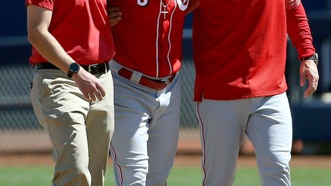 <p>               Cincinnati Reds second baseman Scooter Gennett (3) leaves the baseball game with the help of manager David Bell, right, and head athletic trainer Steve Baumann, left, after he was injured in the second inning of a spring training baseball game against the Milwaukee Brewers, Friday, March 22, 2019, in Phoenix. (AP Photo/Ross D. Franklin)             </p>