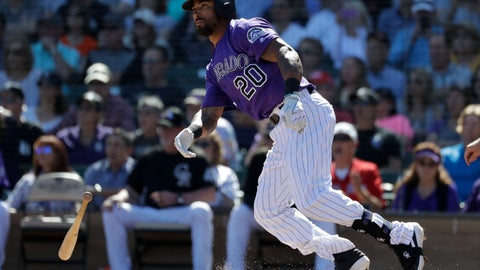 <p>               Colorado Rockies' Ian Desmond hits an RBI-single against the San Francisco Giants during the first inning of a spring baseball game in Scottsdale, Ariz., Sunday, March 3, 2019. (AP Photo/Chris Carlson)             </p>