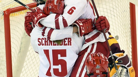 <p>               Wisconsin's Sophia Shaver (12), left, is hugged by teammates after scoring the first goal of the NCAA Division I women's Frozen Four hockey championship game during the first period against Minnesota, Sunday, March 24, 2019, in Hamden, Conn. (AP Photo/Stephen Dunn)             </p>