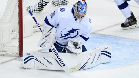 <p>               Tampa Bay Lightning goaltender Andrei Vasilevskiy, of Russia, stops the puck during the third period of the team's NHL hockey game against the Washington Capitals, Wednesday, March 20, 2019, in Washington. The Lightning won 5-4 in overtime. (AP Photo/Nick Wass)             </p>