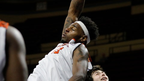 <p>               Georgetown (Ky.) forward Chris Coffey (13) dunks the ball as Carroll forward Match Burnham (12) defends in the NAIA championship men's college basketball game, Tuesday, March 26, 2019, in Kansas City, Mo. (AP Photo/Colin E. Braley)             </p>