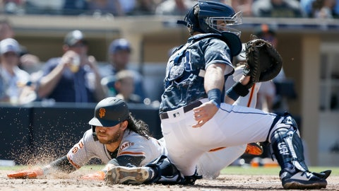 <p>               San Francisco Giants' Brandon Crawford, left, slides into home to beat the throw to San Diego Padres catcher Austin Hedges, right, on an RBI double by Pablo Sandoval during the fifth inning of a baseball game in San Diego, Sunday, March 31, 2019. (AP Photo/Alex Gallardo)             </p>