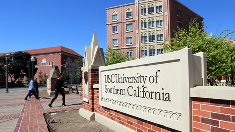<p>               FILE - This Tuesday, March 12, 2019 file photo shows the University Village area of the University of Southern California in Los Angeles. The university says a review of students possibly connected to a college admissions bribery scandal could lead to expulsions. The university said in a statement Monday, March 18, 2019, it has placed holds on the accounts of those students, which prevents them from registering for classes or acquiring transcripts while their cases are under review. (AP Photo/Reed Saxon,File)             </p>