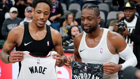 <p>               Miami Heat guard Dwyane Wade, right, and San Antonio Spurs guard DeMar DeRozan pose for photographers after exchanging jerseys following an NBA basketball game Wednesday, March 20, 2019, in San Antonio. Miami won 110-105. (AP Photo/Darren Abate)             </p>