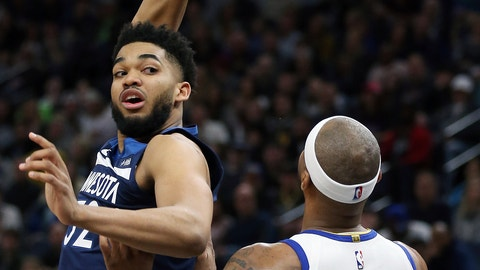 <p>               Minnesota Timberwolves' Karl-Anthony Towns passes the ball behind his head as Golden State Warriors' DeMarcus Cousins defends during the first half of an NBA basketball game Friday, March 29, 2019, in Minneapolis. (AP Photo/Stacy Bengs)             </p>