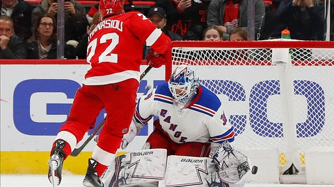 <p>               Detroit Red Wings center Andreas Athanasiou scores a shootout goal against New York Rangers goaltender Henrik Lundqvist (30) during an NHL hockey game Thursday, March 7, 2019, in Detroit. Detroit won 3-2. (AP Photo/Paul Sancya)             </p>