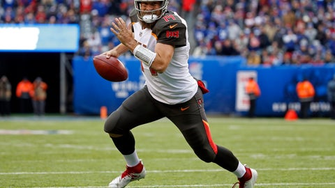 <p>               FILE - In this Nov. 18, 2018, file photo, Tampa Bay Buccaneers quarterback Ryan Fitzpatrick (14) rushes for a touchdown against the New York Giants during an NFL football game in East Rutherford, N.J. Fitzpatrick has agreed to terms on a two-year contract with the Miami Dolphins, who were in the market for a replacement to Ryan Tannehill. Fitzpatrick, 36, has a 50-75-1 record as a starter for seven NFL teams. He started seven games for Tampa Bay last year and had a passer rating of 100.4, which ranked ninth in the league. (AP Photo/Adam Hunger, File)             </p>