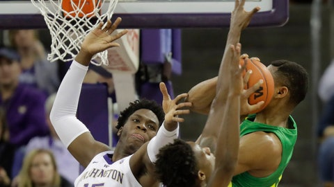 <p>               Washington forward Noah Dickerson (15) battles with Oregon forward Francis Okoro, right, for a rebound during the first half of an NCAA college basketball game, Saturday, March 9, 2019, in Seattle. (AP Photo/Ted S. Warren)             </p>