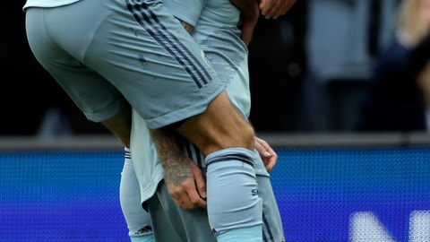 <p>               Sporting Kansas City midfielder Graham Zusi (8) celebrates a goal scored by forward Johnny Russell, right, during the first half of an MLS soccer match against the Montreal Impact in Kansas City, Kan., Saturday, March 30, 2019. (AP Photo/Orlin Wagner)             </p>